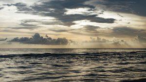 ocean waves light clouds